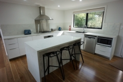 Kitchen with stone bench tops